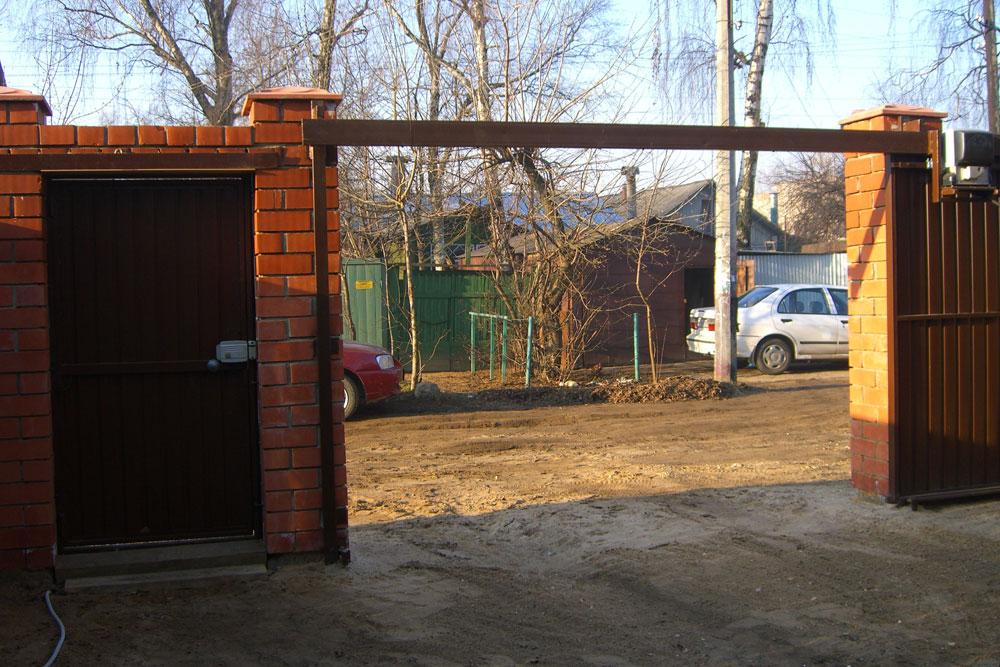 Ворота подвесные откатные своими руками фото